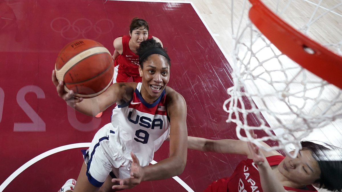 United States's A'Ja Wilson (9) drives past Japan's Himawari Akaho (88) during a women's gold...