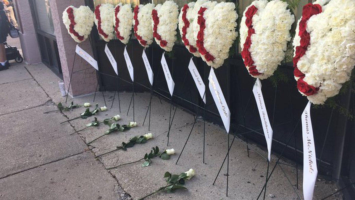 Flowers placed as memorials to victims killed in Dayton mass shooting