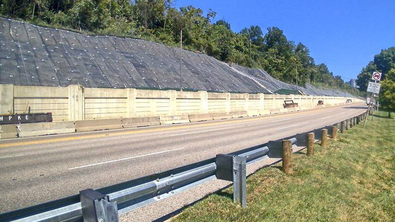 Work to stabilize the uphill side of Columbia Parkway following a series of landslides in 2019...