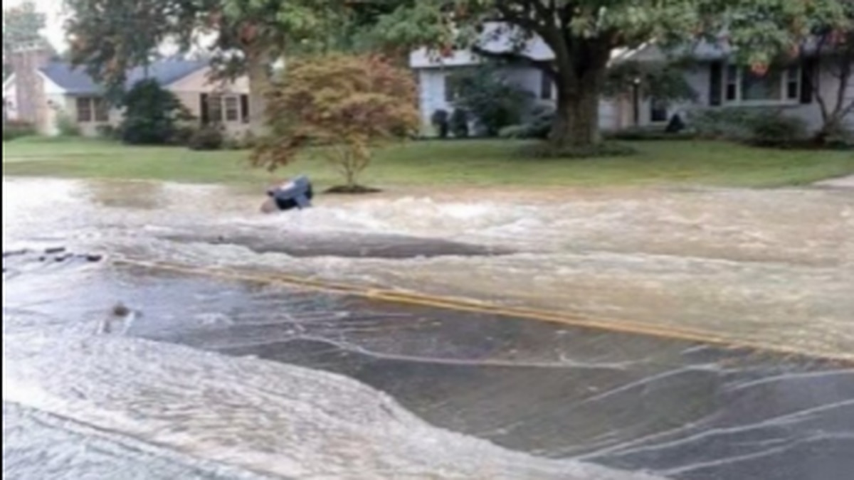 A large water main break is visibly flooding a northern Kentucky street and front yards...