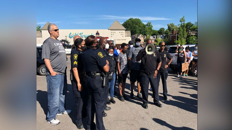Cincinnati officers and firefighters march in Avondale Black Lives Matter protest.