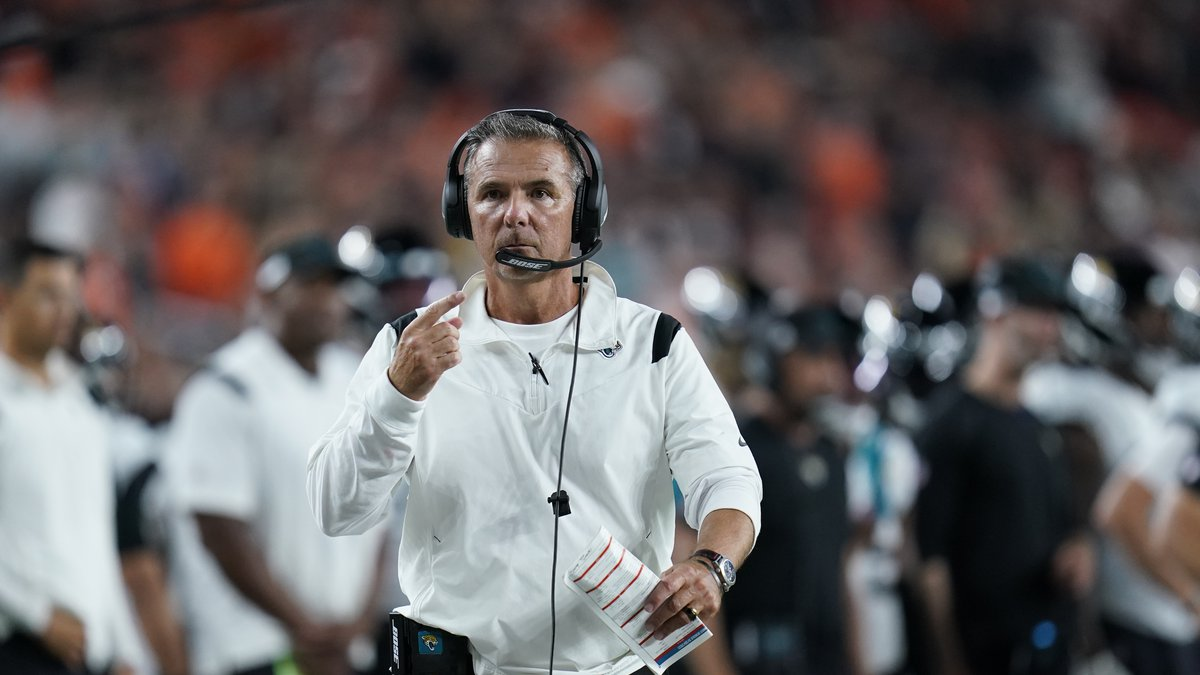 Jacksonville Jaguars head coach Urban Meyer walks with an official during the first half of an...