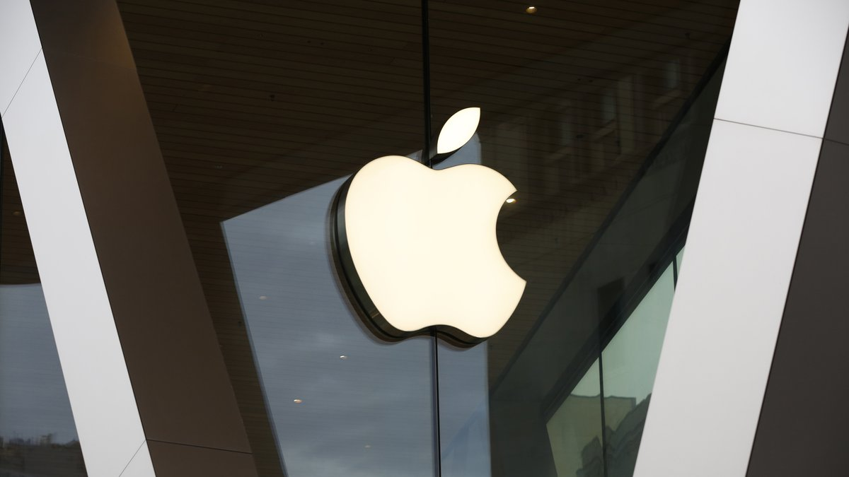 FILE - In this Saturday, March 14, 2020 file photo, an Apple logo adorns the facade of the...