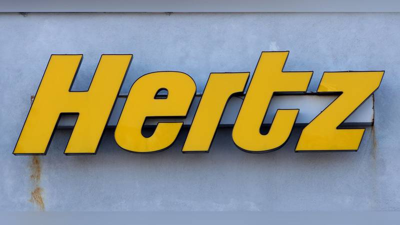 FILE - In this Tuesday, Nov. 28, 2017 photo, a Hertz rental car logo is seen on the front of a...