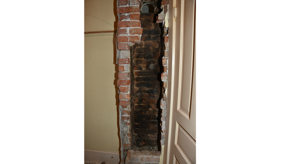 This photo shows the wall and bricks that were removed to recover the body of Harley Dilly. The...
