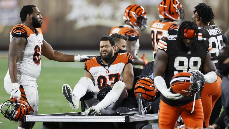 Cincinnati Bengals tight end C.J. Uzomah (87) is driven off the field after an injury during...