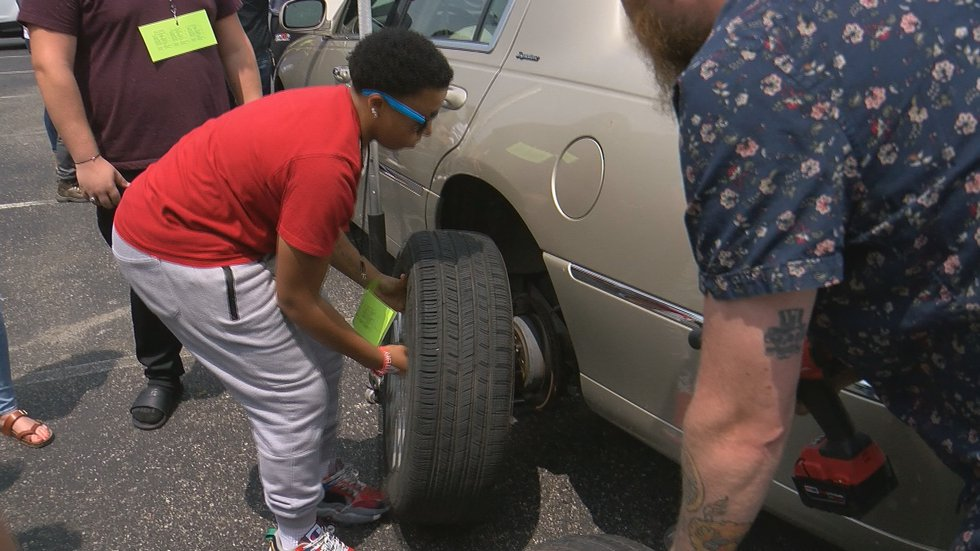 Graduating Fern Creek High students learned how to change a tire on Tuesday.
