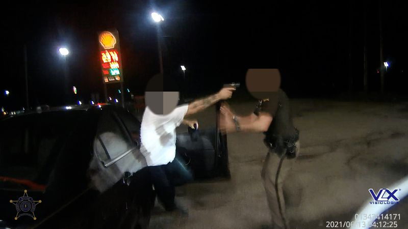 A Boone County Sheriff's Deputy had a gun pointed in their face.