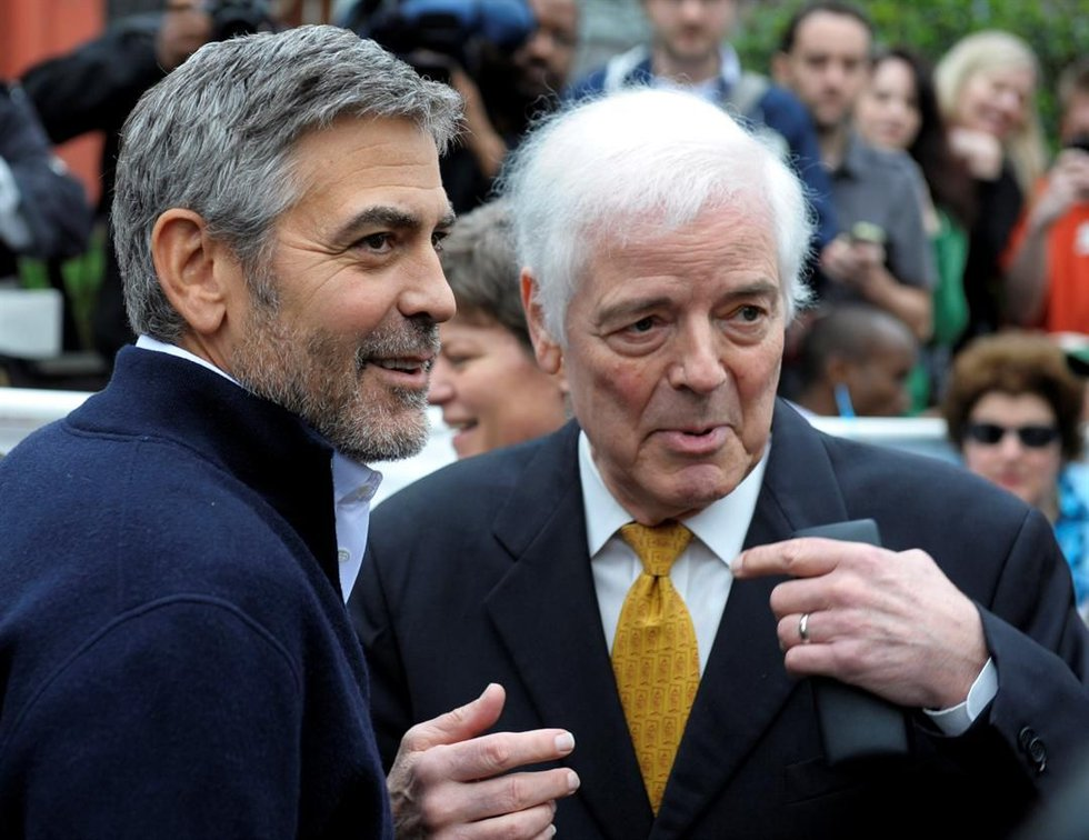 Actor George Clooney, left, and his father Nick Clooney, take part in a protest at the Sudan...