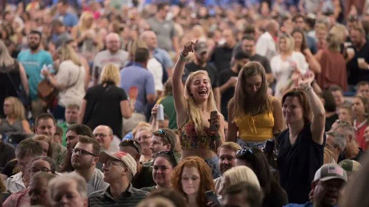 fans dance between the Goo Goo Dolls performance and Train's performance on Wednesday, July 24,...