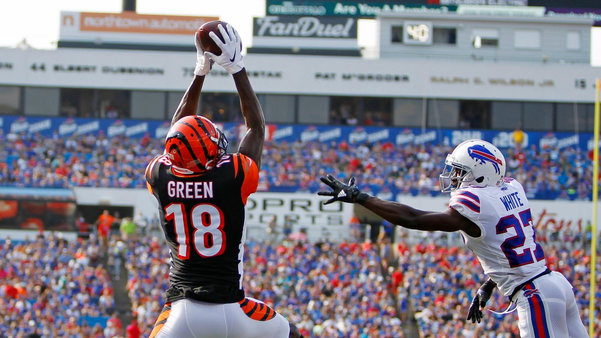 Cincinnati Bengals wide receiver A.J. Green (18) catches a pass for a touchdown in front of...