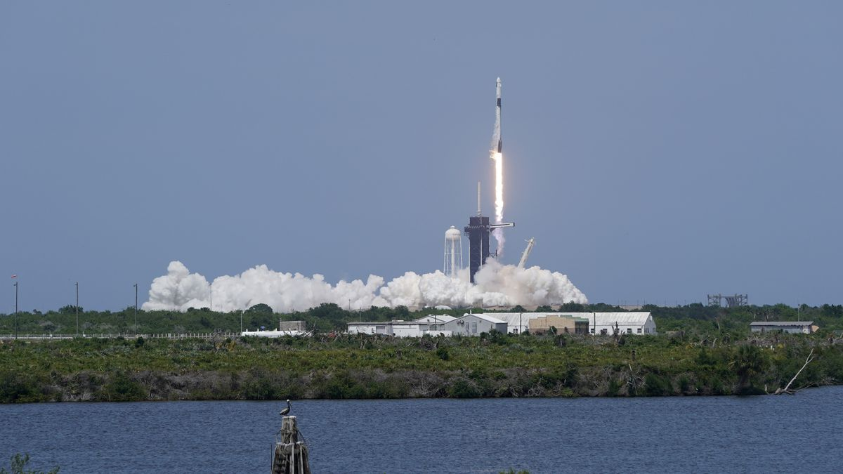 A SpaceX Falcon 9, with NASA astronauts Doug Hurley and Bob Behnken in the Crew Dragon capsule,...