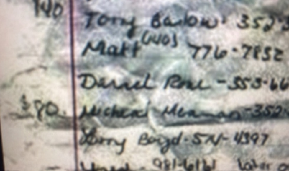 Megan Lancaster's notebook lists Michael Mearan's name, phone number and $80.