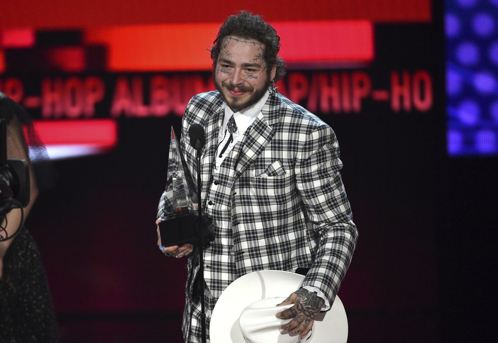 """Post Malone accepts the award for favorite rap/hip-hop album for """"Hollywood's Bleeding"""" at the..."""