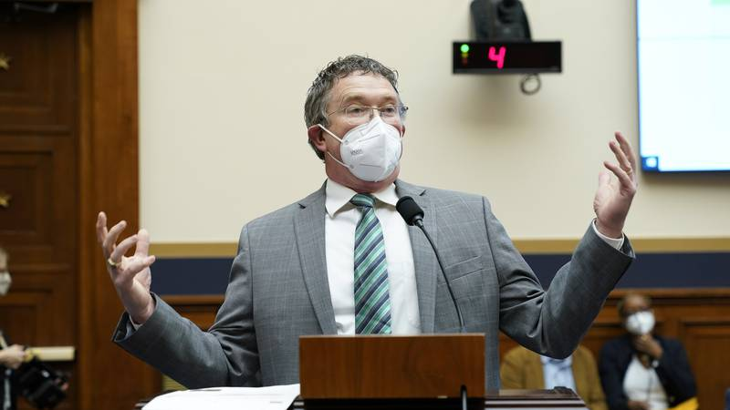 Rep. Thomas Massie, R-Ky., complains about being required to wear a face mask as he attends a...