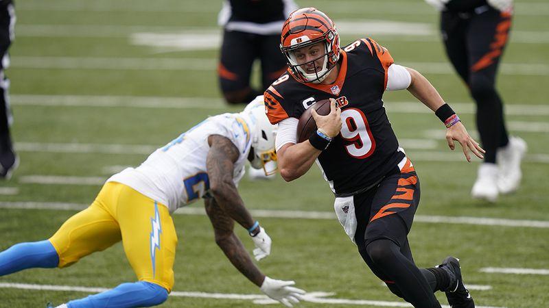 Cincinnati Bengals quarterback Joe Burrow (9) runs past Los Angeles Chargers' Rayshawn Jenkins...