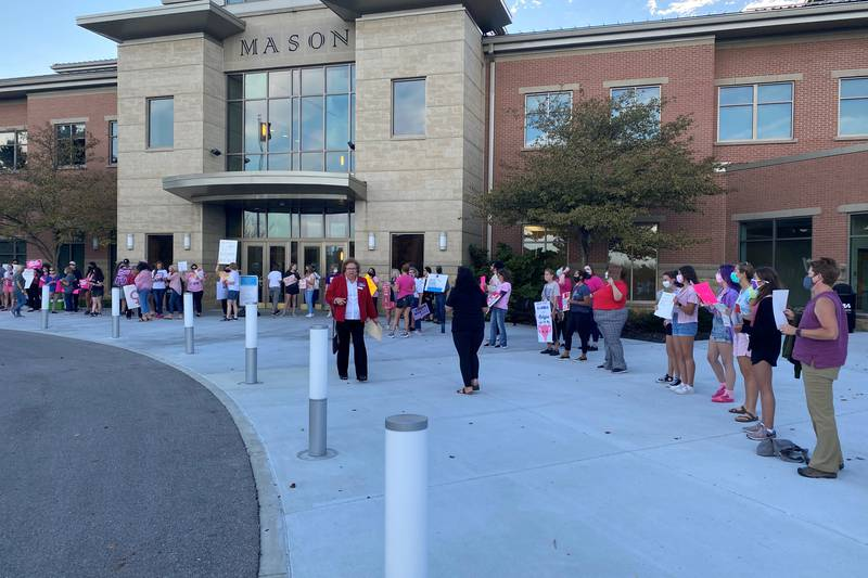 Demonstrators stand outside ahead of Mason City Council earlier this month when an ordinance...