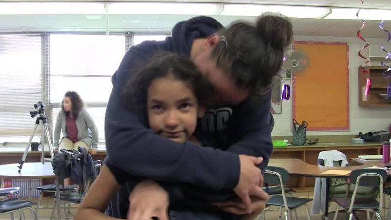 Deployed mom surprises her daughter at Brook Park Memorial School.