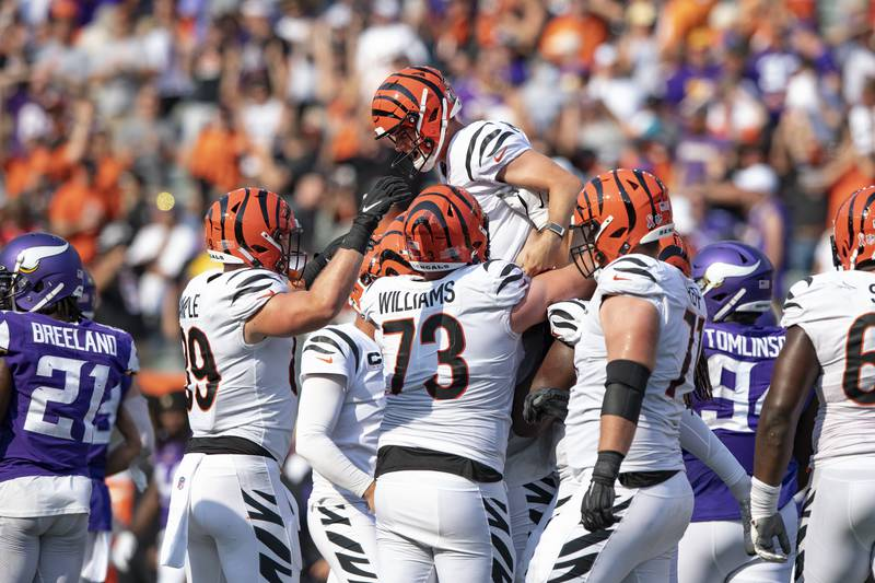 Cincinnati Bengals kicker Evan McPherson (2) is lifted by teammates after a field goal to...