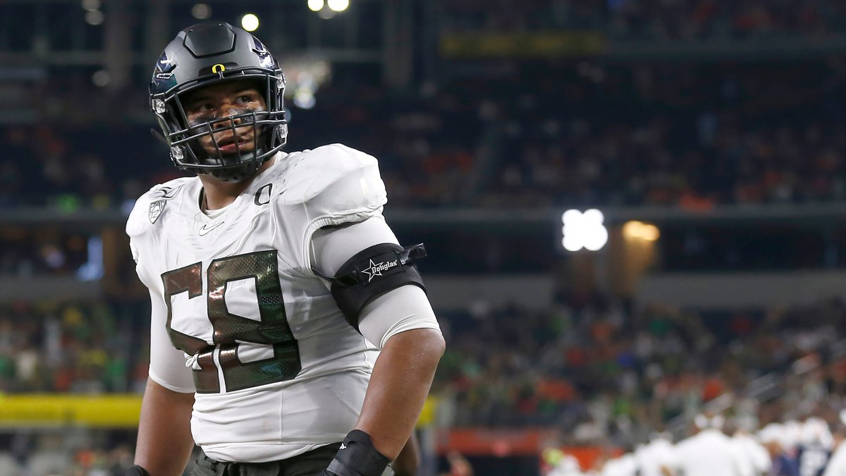 FILE - In this Aug. 31, 2019, file photo, Oregon offensive lineman Penei Sewell (58) looks on...