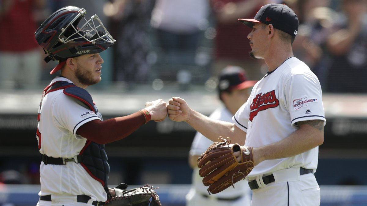 Cleveland Indians relief pitcher Nick Wittgren, right, is congratulated by catcher Roberto...