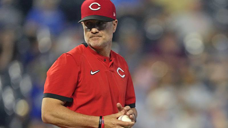Cincinnati Reds manager David Bell stands on the mound as he makes a pitching change during the...