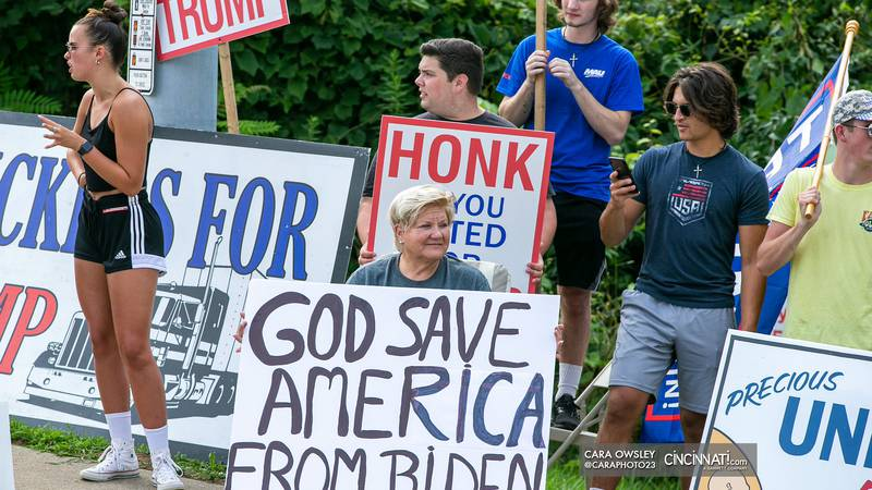 Protesters gather outside a union training facility on Cincinnati's West Side as President...