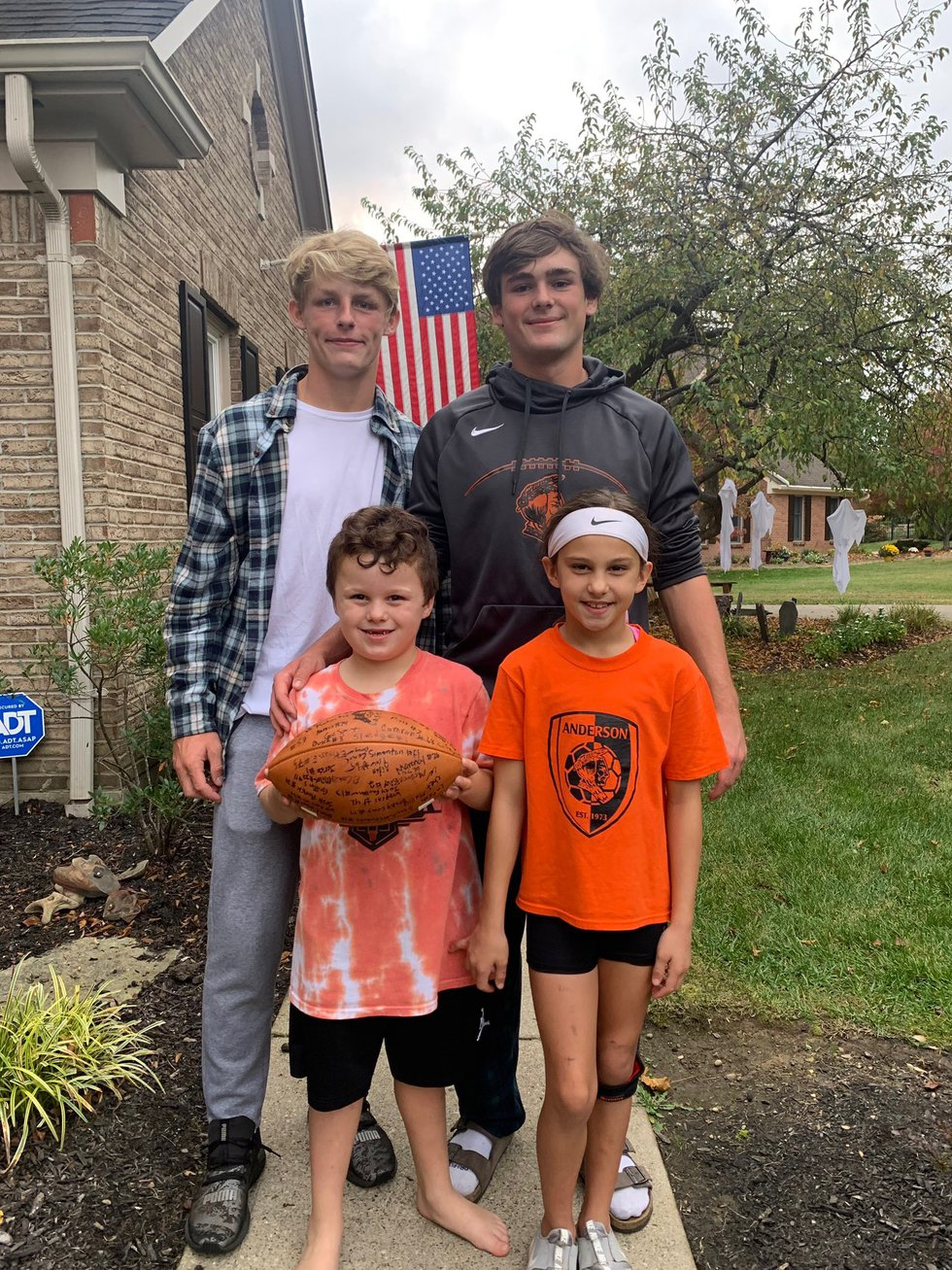 Anderson football players signed a football for Danny Celenza's kids after his passing