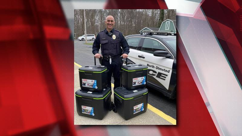 North Olmsted Patrolman makes stops with Meals on Wheels for the elderly.