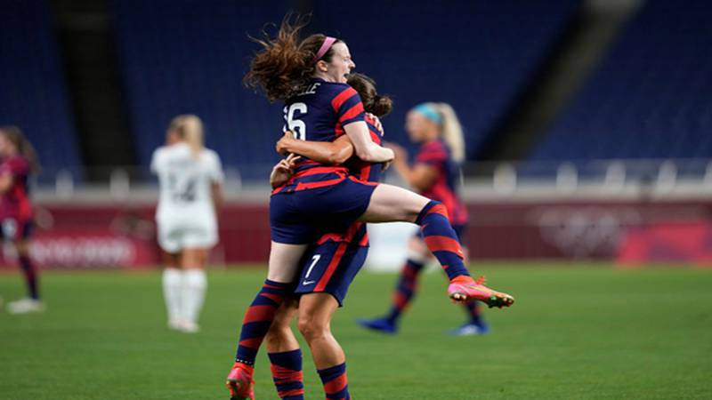 United States Rose Lavelle, left, celebrates after scoring a goal during the women's soccer...