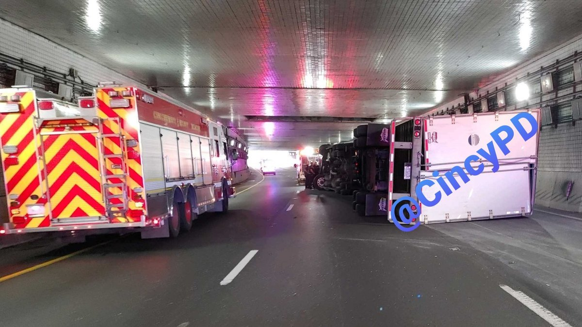 Police say a semi has overturned in Lytle Tunnel.