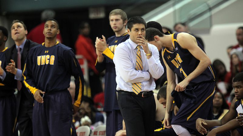 UNC- Greensboro head coach Wes Miller paces the sidelines during an NCAA basketball game...