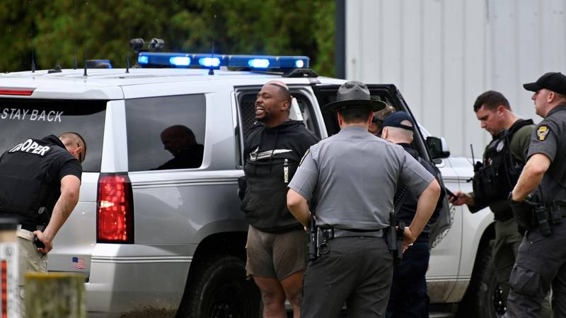 Police arrest Robert Tremaine Hathorn after an hours long search following the shooting of an...