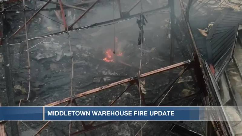 Massive Middletown warehouse fire continues to smolder