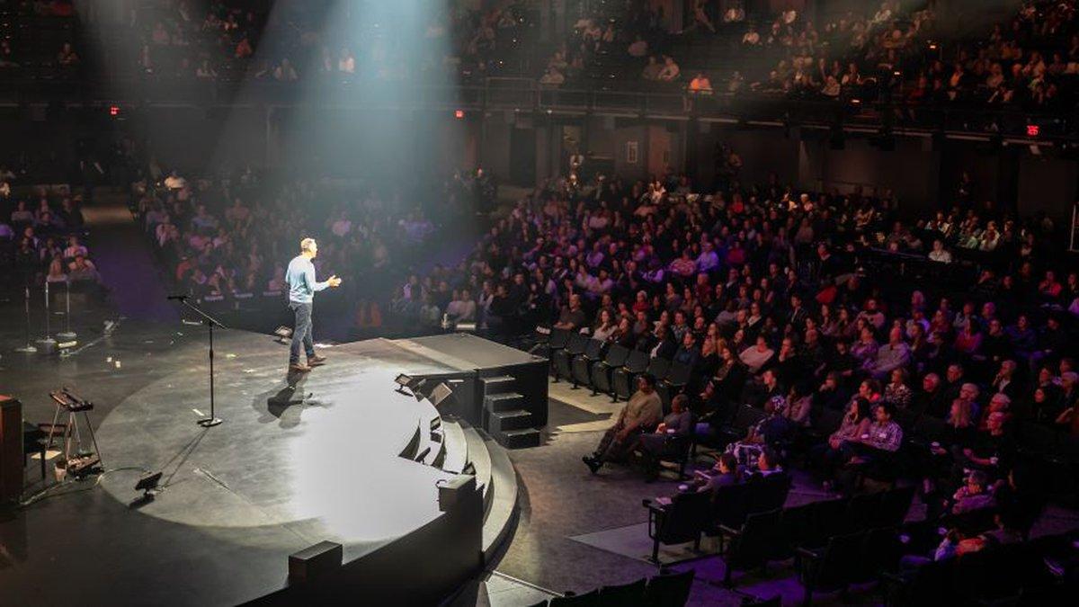 Senior Pastor Brian Tome speaking in Oakley auditorium.