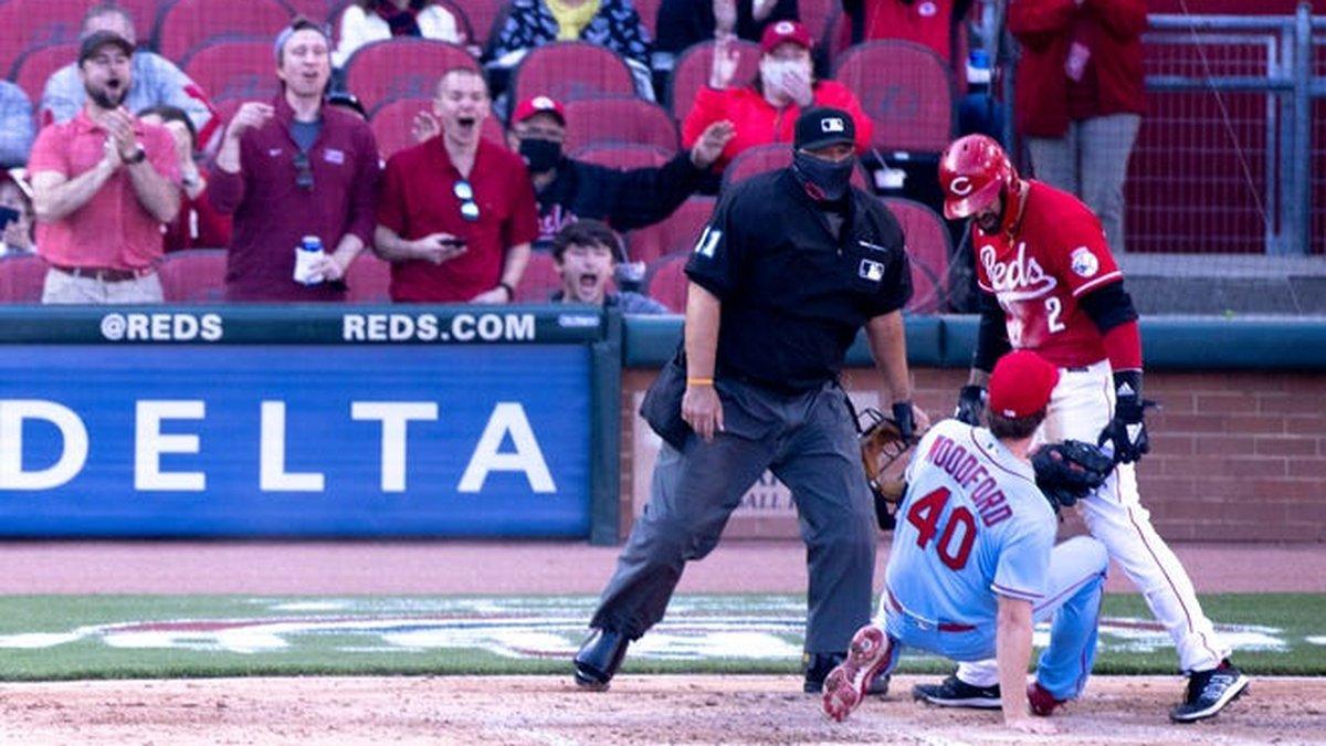 Cincinnati Reds right fielder Nick Castellanos exchanges words with St. Louis Cardinals...