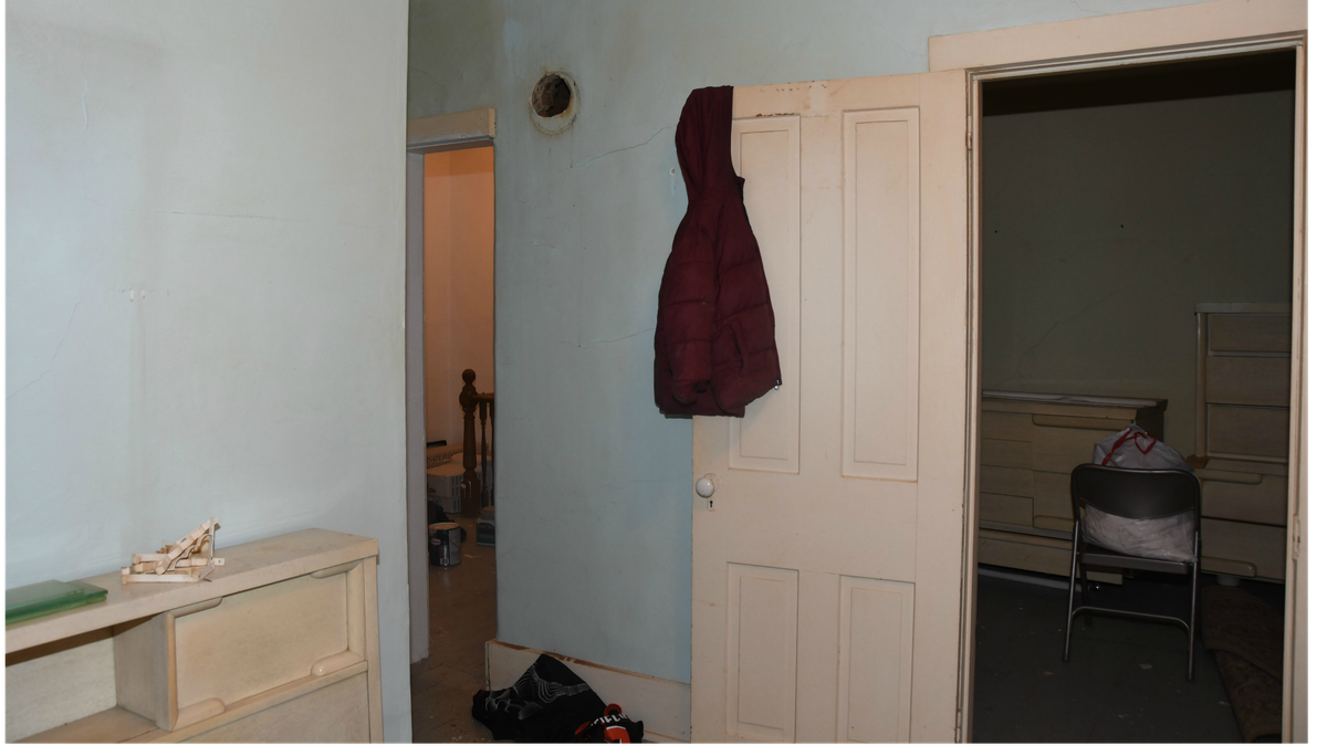 This evidence photo shows Harley Dilly's coat hanging from a door. It was placed there by the...