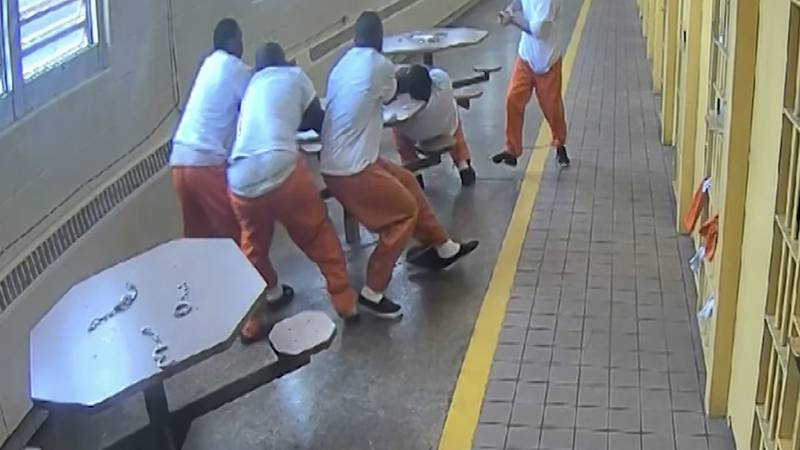 In this screenshot taken from a Southern Ohio Correction Facility security camera video four...