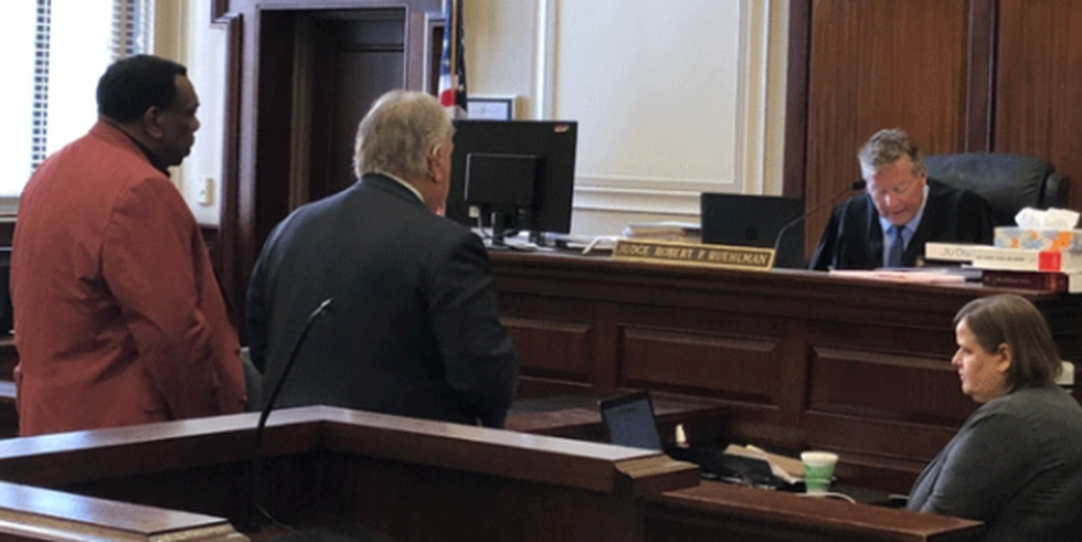 Cincinnati City Councilman Wendell Young (left) and his lawyer, Scott Croswell (right) face...