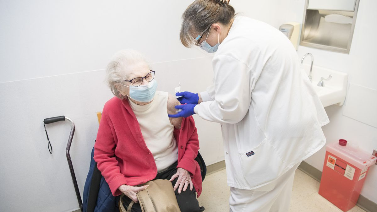 Ann Woehrmann, 98, receives the COVID-19 vaccine at the Cleveland Clinic