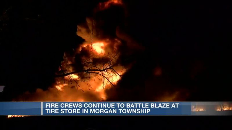 Crews working to contain environmental impact of tire dealer fire