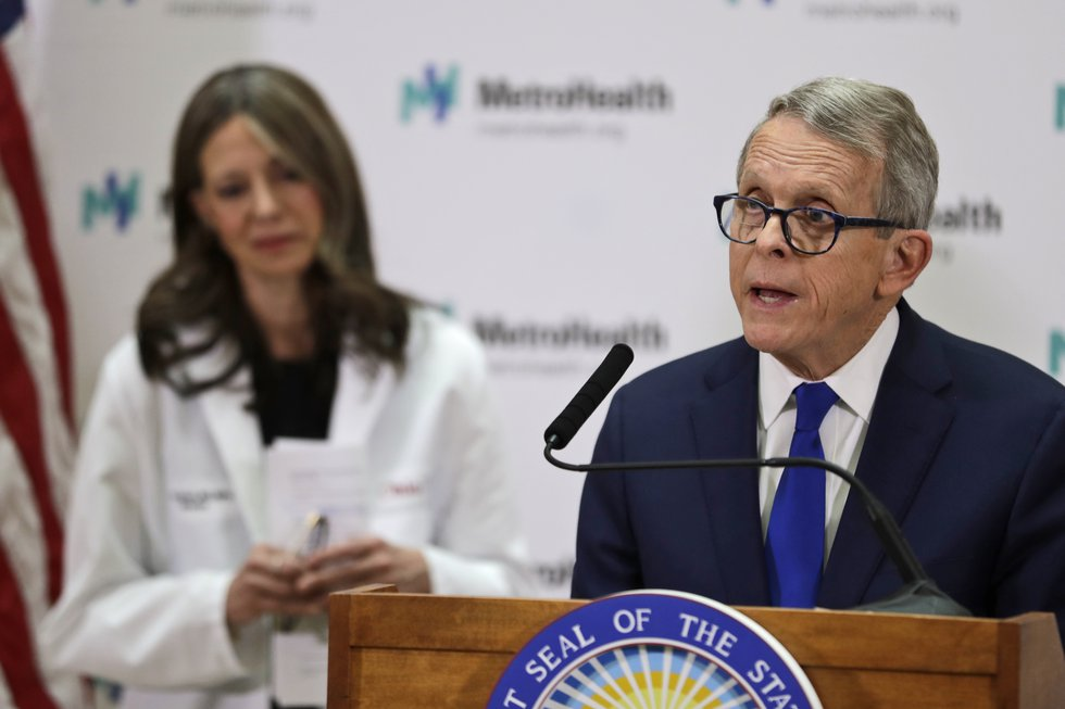 Gov. Mike DeWine and Ohio Department of Health Director Dr. Amy Acton speak at a recent press...
