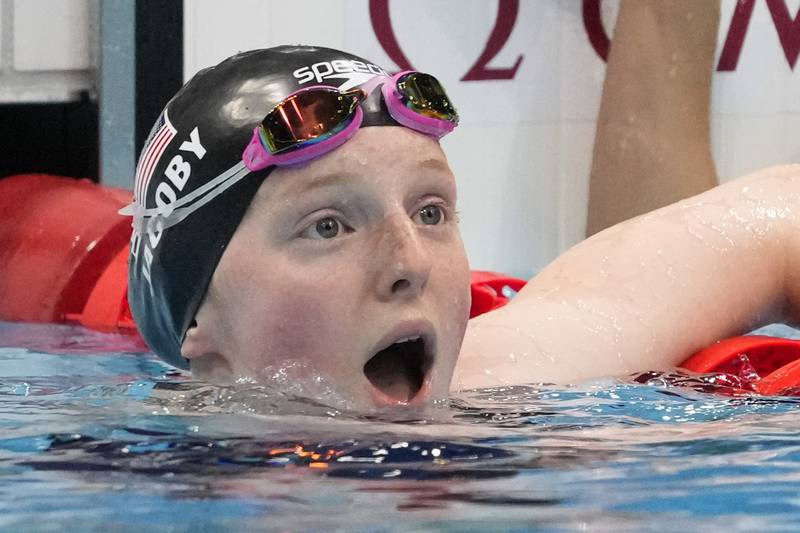 Lydia Jacoby, of the United States, reacts after winning the final of the women's 100-meter...