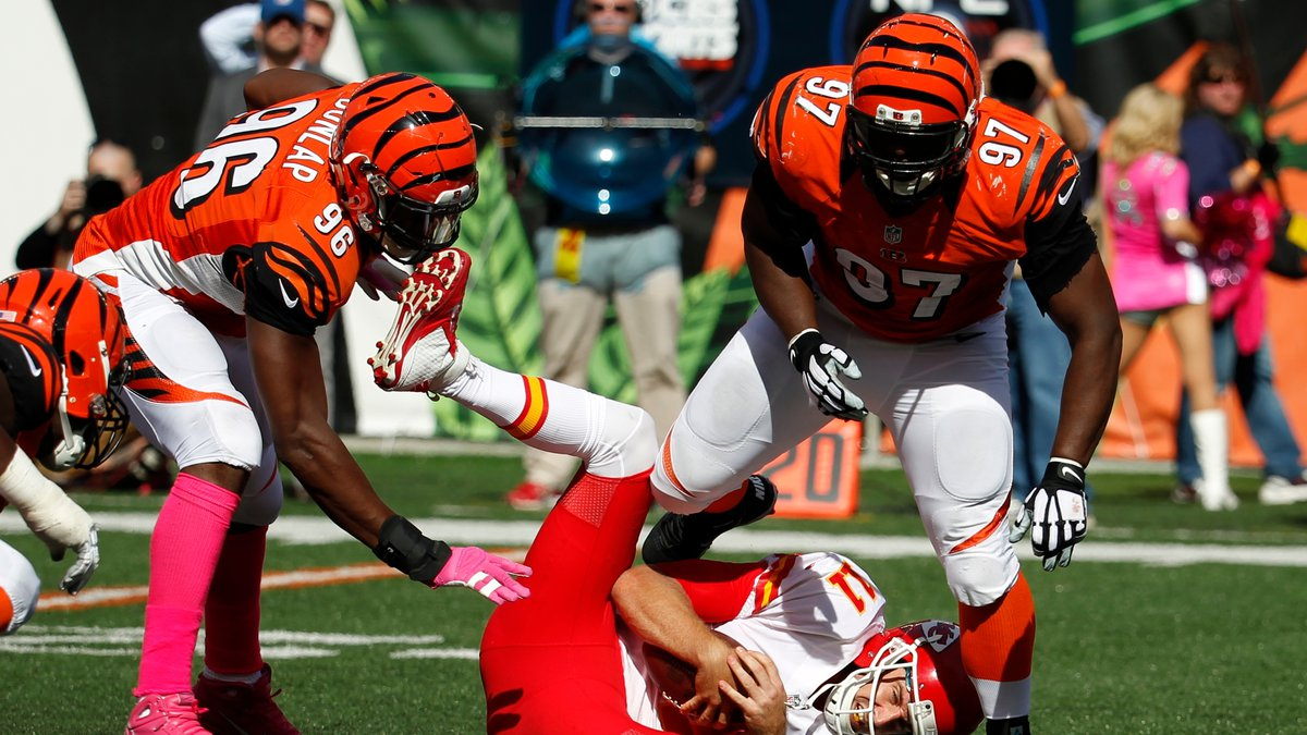 Kansas City Chiefs quarterback Alex Smith (11) is sacked by Cincinnati Bengals defensive tackle...