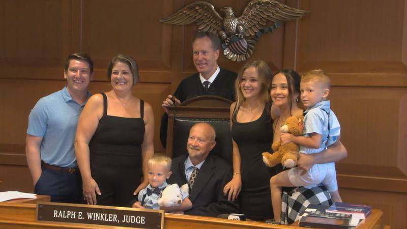 Hamilton County Judge Ralph Winkler and a family on adoption day.