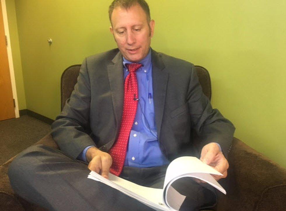 Attorney Brian Shrive pores over secret Cincinnati City Council text messages released Friday...