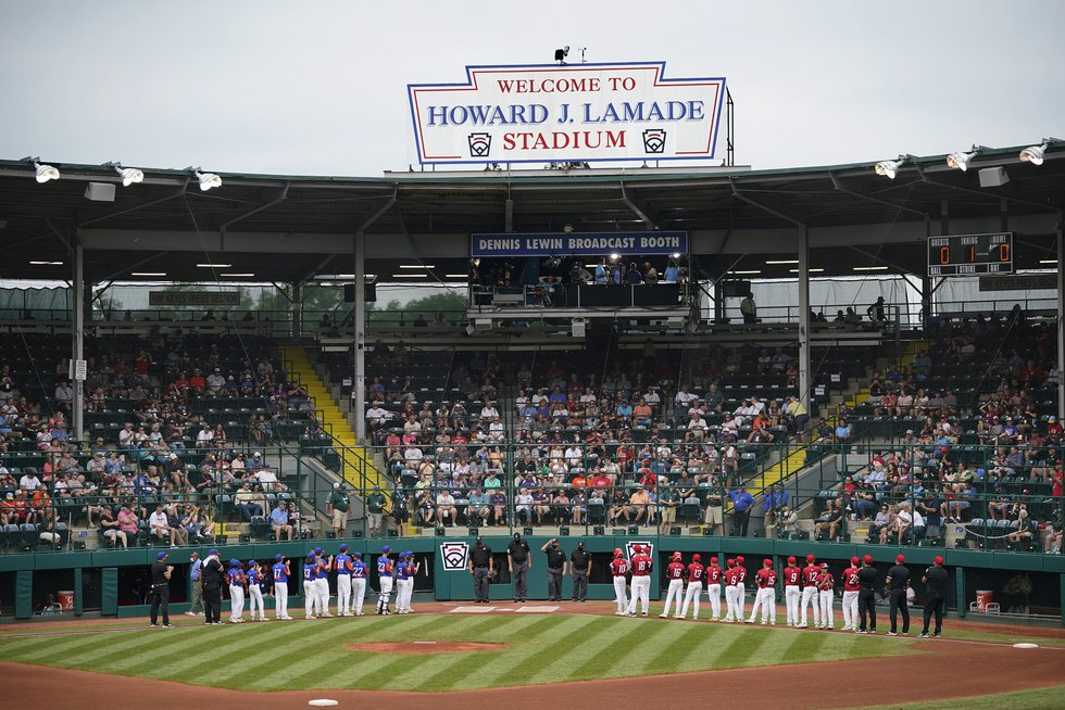 Hamilton, Ohio, lines the third base line and Taylor, Mich., line up on the first base line...