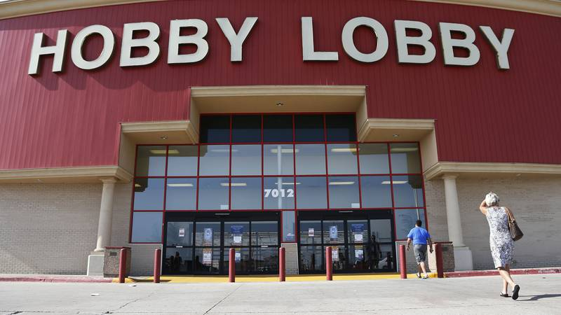 FILE - In this Monday, June 30, 2014, file photo, customers walk to a Hobby Lobby store in...