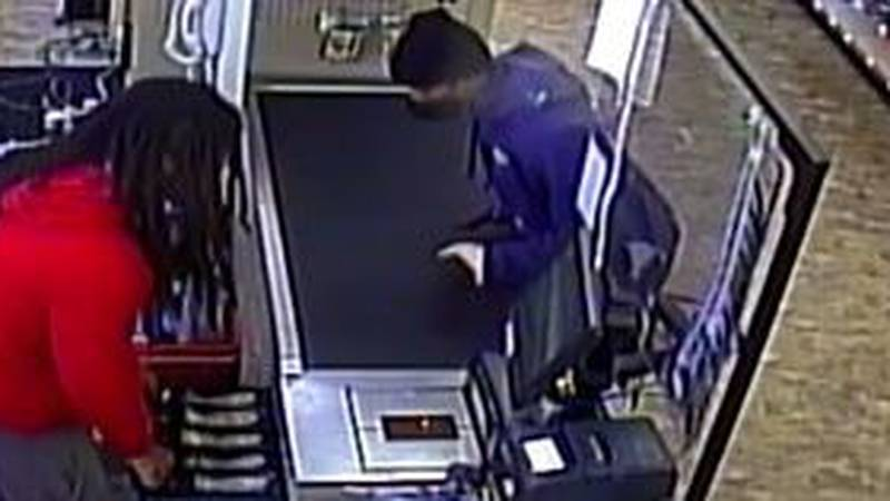 Police are investigating after they say the man in purple robbed the Family Dollar in North...