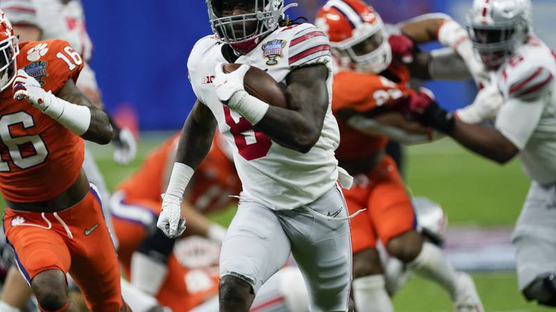 Ohio State running back Trey Sermon runs for a touchdown against Clemson during the first half...